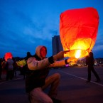 A young man launches a paper lantern during a ceremony to mark Earth Hour at the main square in Vladivostok, Russia's Far East, about 9,300 kilometres east of Moscow.(AP Photo/Alexander Khitrov)