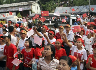 Supporters of the National League for Democracy gather outside the party headquarters in Yangon to await news from the national by-elections.