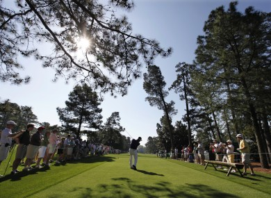 KJ Choi tees off during a practice round at Augusta.