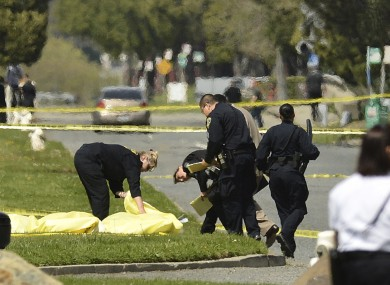 Oakland Police cover bodies after the shooting