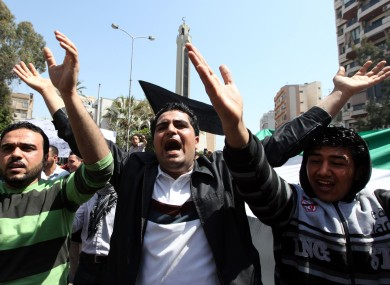 Anti-Syrian regime protesters chant slogans against Syrian President Bashar Assad during a demonstration in Beirut, Lebanon, Friday, April 6