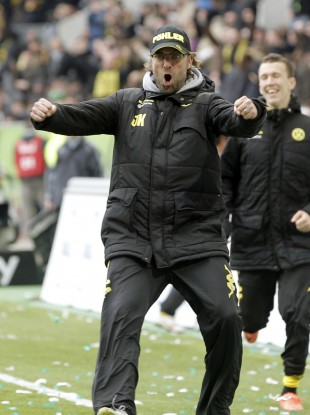 Dortmund coach Juergen Klopp celebrates after his team's 3rd goal last weekend.,