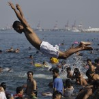A Filipino dives at the polluted waters of Manila's bay, Philippines. (AP Photo/Aaron Favila)