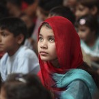 A Pakistani Christian girl, attends Easter mass at St. John's Church in Peshawar. (AP Photo/Mohammad Sajjad)