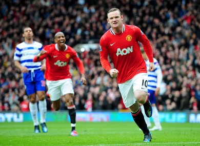 Wayne Rooney celebrates his penalty... and quite possibly a 20th United title