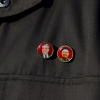 A North Korean official wears pins showing the late North Korean leaders Kim Il Sung and Kim Jong Il during a tour of the North Korea's Unha-3 rocket at Sohae Satellite Station in Tongchang-ri, North Korea on Sunday 8 April (AP Photo/David Guttenfelder)