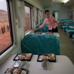 A North Korean waitress serves packaged meals for lunch on a train heading to North Phyongan Province, about 50 kilometers south of the border town of Sinuiju along North Korea's west coast (AP Photo/Ng Han Guan)