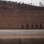 North Koreans soldiers march along a rural road seen from a train heading to North Phyongan Province (AP Photo/David Guttenfelder)