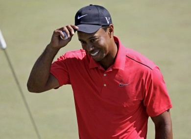 Woods acknowleges the crowd after putting on the 18th green on Sunday.