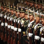 Chinese Honour guards line up before a welcoming ceremony for Turkey's Prime Minister Recep Tayyip Erdogan in the Great Hall of the People in Beijing, China. (AP Photo/Rajesh Kumar Singh)
