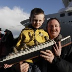 Scully, 6, holding a model of the Titanic, poses for pictures with Lload Walsh, as they wait to greet the disembarking passengers of the MS Balmoral Titanic memorial cruise ship at its first stop in Cobh (AP Photo/Lefteris Pitarakis)