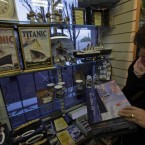 A woman looks on Titanic souvenirs at a shop in Cobh (AP Photo/Lefteris Pitarakis)