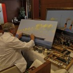 A painter works on paintings depicting the Titanic, aboard the MS Balmoral Titanic memorial cruise ship (AP Photo/Lefteris Pitarakis)