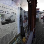 A shop with a window decorated with a poster of a newspaper featuring news and a photograph of the Titanic (AP Photo/Lefteris Pitarakis)