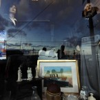 A shop with a window decorated on the Titanic theme (AP Photo/Lefteris Pitarakis)