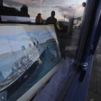 A shop with a window decorated with a painting of the Titanic in Cobh (AP Photo/Lefteris Pitarakis)