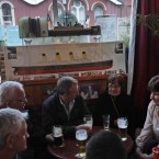 People enjoy their drink at a pub decorated with models and paintings of the Titanic in Cobh (AP Photo/Lefteris Pitarakis)
