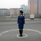 A female North Korean traffic coordinator stands on duty in Pyongyang (AP Photo/Ng Han Guan)