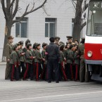 Young North Korean children in uniform prepare to take the public transport in Pyongyang, North Korea on Tuesday (AP Photo/Ng Han Guan)
