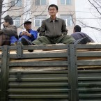 A North Korean men sit on top of wooden planks transported by a truck in Pyongyang, North Korea, Tuesday, April 10, 2012. (AP Photo/Ng Han Guan)