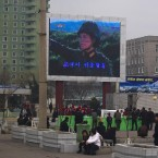 A military-themed movie is broadcast on a large TV screen near the train station in Pyongyang on Tuesday (AP Photo/David Guttenfelder)