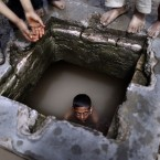 A Pakistani boy swims in a water reservoir to cool off as the temperature rises. (AP Photo/Muhammed Muheisen)