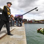 Admiral Lord West casts a memorial wreath to victims of the Titanic disaster into the dock in Southampton, from where the ill-fated liner sailed 100 years ago today.