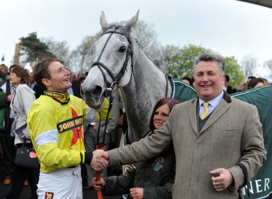 Jockey Daryl Jacob celebrates with Neptune Collonges and trainer Paul Nicholls.