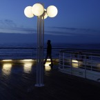 A passenger of MS Balmoral Titanic memorial cruise ship, gazes out to the Atlantic Ocean, following a memorial service, marking the 100-year anniversary of the Titanic disaster, in the early hours of Sunday, April 15, 2012. (AP Photo/Lefteris Pitarakis)