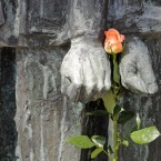 A rose hangs between the hands of prisoners, a memorial in front of the crematory, during the commemoration ceremonies for the 67th anniversary of the liberation of former Nazi concentration camp Mittelbau-Dora near Nordhausen, central Germany. (AP Photo/Jens Meyer)