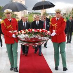Libyan National Transitional Council's Mustapha Abdeljali, right behind, with Algerian Interior Minister Dahou Oud Kablia, lay a wreath of flowers at a war memorial in Algiers (AP Photo/Ouahab Hebbat)