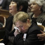Assemblywoman Mariko Yamada, D-Davis, hugs Holocaust survivor Rivka Spiegel, right, as she wipes her eyes during the 2012 California Holocaust Memorial Ceremony held at the Capitol in Sacramento, California. (AP Photo/Rich Pedroncelli)