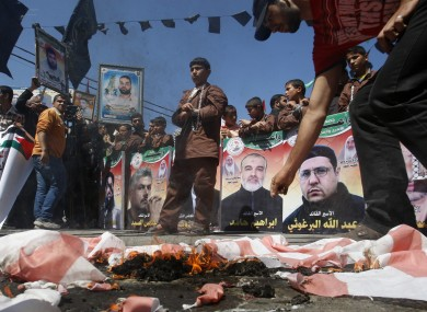 Palestinians mark the annual prisoners day in Gaza earlier today