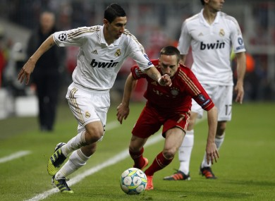 Madrid's Angel Di Maria, left, and Bayern's Franck Ribery challenge for the ball.