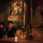 Americans Sylvia Chester and her partner Mike, both of Huston, TX and passengers of the MS Balmoral Titanic memorial cruise ship, dressed in period costume, enjoy a drink at a pub in Halifax, Canada. (AP Photo/Lefteris Pitarakis)