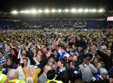 Reading fans celebrate on the pitch.
