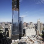 One World Trade Center, now up to 100 floors, rises above the lower Manhattan skyline and the National September 11 Memorial. The tower is scheduled to be completed in 2013. (AP Photo/Mark Lennihan)