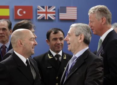 Italian Defence Minister Giampaolo Di Paola, third right, speaks with Supreme Allied Commander Europe, US Navy Admiral James Stavridis, at the summit in Belgium.