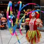 A young woman performs with a coloured ribbons at a shopping mall to celebrate the National Sovereignty and Children's Festival which marks the 92nd anniversary of the opening of Turkey's National Assembly, in Ankara. (AP Photo/Selcan Hacaoglu)