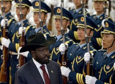 South Sudan president Salva Kiir reviews an honour guard in Beijing today
