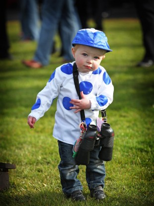 Young racing fan Kieran John Kelly (1) from Wicklow enjoying the races during day one of the Punchestown Festival.
