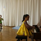 A North Korean girl plays the piano in Pyongyang, North Korea. (AP Photo/Vincent Yu)
