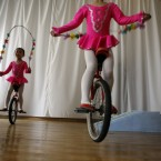 North Korean children on unicycles skip ropes for a performance at the Kaeson Kindergarden in Pyongyang. (AP Photo/Ng Han Guan)