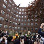 A crowd watches as a piano falls from the roof of Baker House dormitory at Massachusetts Institute of Technology in Cambridge, Massachusetts.  (AP Photo/Michael Dwyer) (AP Photo/Michael Dwyer)