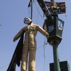 An effigy representing Egypt's ruling military council and top officials who served with Hosni Mubarak's ousted regime is hanged during a rally in Tahrir Square in Cairo Egypt. (AP Photo/Amr Nabil)