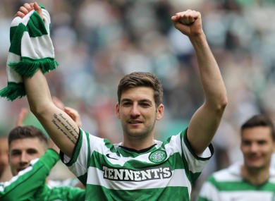 Charlie Mulgrew celebrates his side's victory.