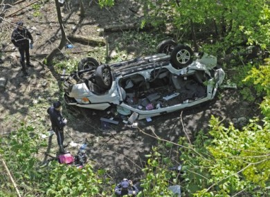 New York police investigate the wreck of yesterday's Bronx Zoo crash.