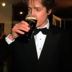 Back at home in Blighty, Hugh Grant would have been having a pint of beer/ale. Here, in Dublin in 1995, he was having a gargle. Slightly bizarre choice of synonym for it as alcohol is never knowingly gargled in Ireland, and much more likely to be swallowed. (Pic: Eamonn Farrell/Photocall Ireland)