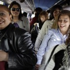 A group of women arrive in a bus before a meeting between men and women at the village of Candeleda, central Spain. 68 women were bussed in to the village to meet with the local men with the hope that some will form relationships and settle in the village where the main population is male.  (AP Photo/Alberto Di Lolli)
