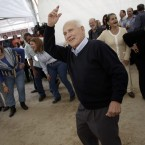 German, 82, center, dances during a meeting between men and women at the village of Candeleda, central Spain. (AP Photo/Alberto Di Lolli)